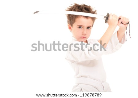 Little boy in kimono with sword isolated on white - stock photo