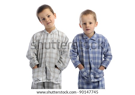 Little boy in pajamas isolated on white background stock photo
