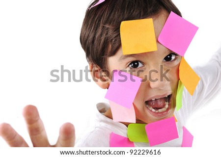Little boy in panic with memo posts on his face - stock photo