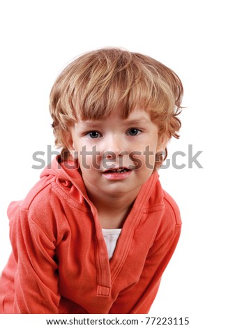 Little boy in pink shirt on white background