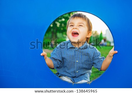 Little boy in playhouse - stock photo