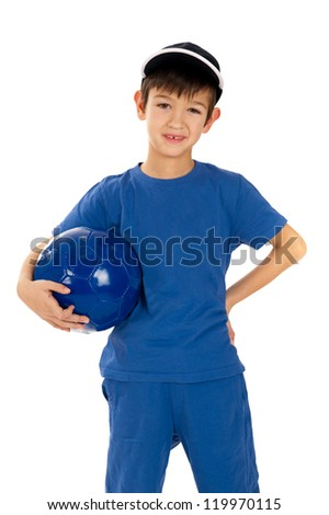 Little boy in soccer uniform with classic soccer ball isolated white background