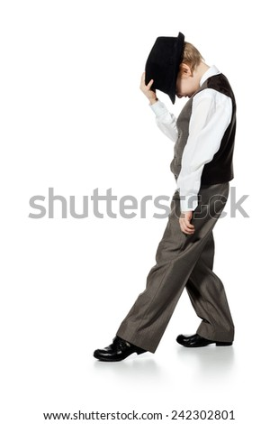 Little boy in suit and hat is dansing, isolated on white. Little boy, who is looked as businessman, is dancing on white background.