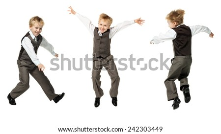 little boy in suit jumping on white background  - stock photo