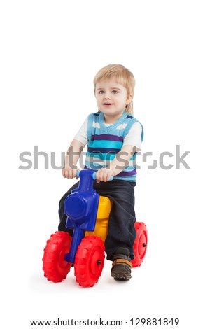 little boy in the bright bike on white background
