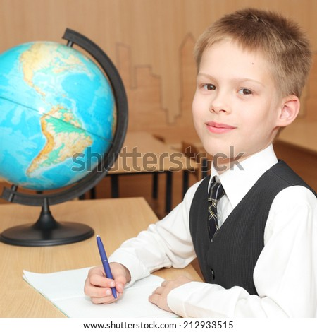 little boy in the classroom - stock photo