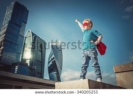 Little boy in the cloak - stock photo