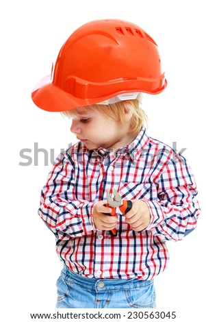 little boy in the construction helmet with a pair of pliers in the hands.Childhood education development in the Montessori school concept. Isolated on white background. - stock photo