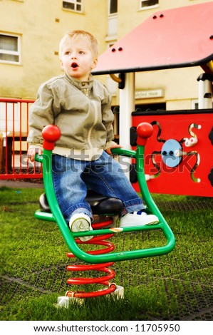 Little boy in the nursery school playground,