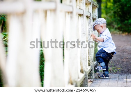 Little boy in the park - stock photo