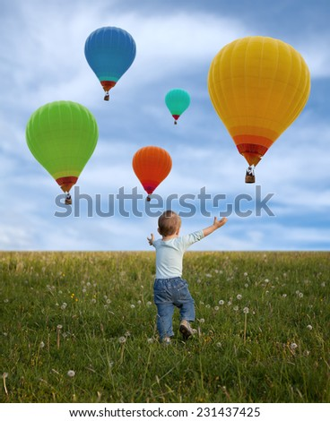 little boy in the spring  meadow and balloons