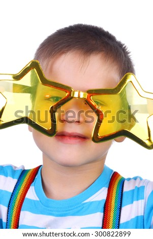 little boy in the yellow humorous star glasses - stock photo