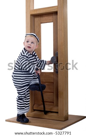 little boy in thief outfit trying to open a closed door