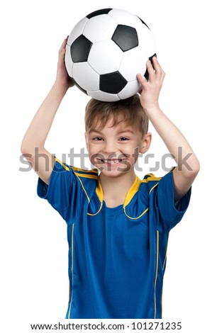 Little boy in ukrainian national soccer uniform with classic soccer ball on isolated white background - stock photo