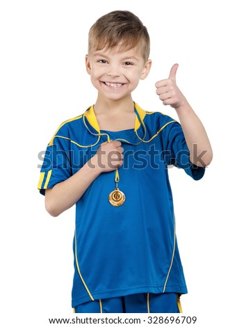 Little boy in ukrainian national soccer uniform with medal on isolated white background - stock photo