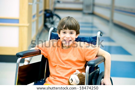 Little Boy in Wheelchair - stock photo