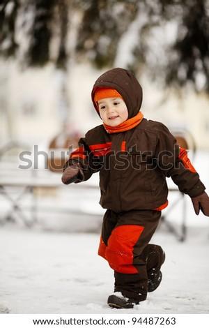 little boy in winter park - stock photo