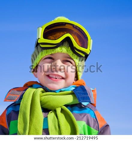 little boy in winter resort - stock photo