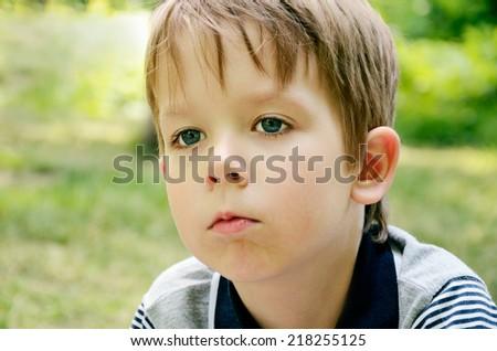 little boy indifferently looking away horizontal - stock photo