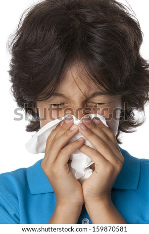 Little boy is blowing his nose on white background