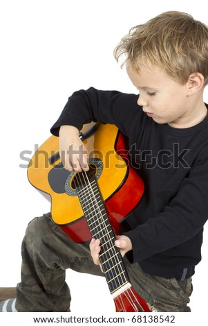 Little boy is composing music on a white background.