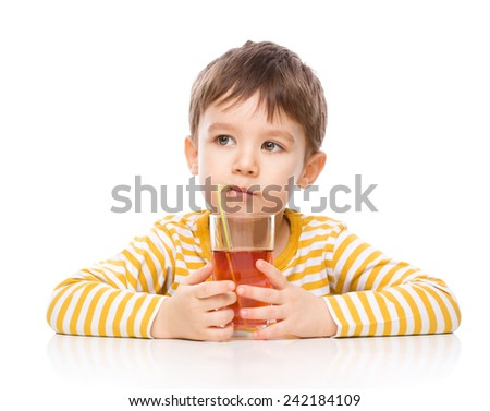 Little boy is drinking apple juice using straw, isolated over white - stock photo