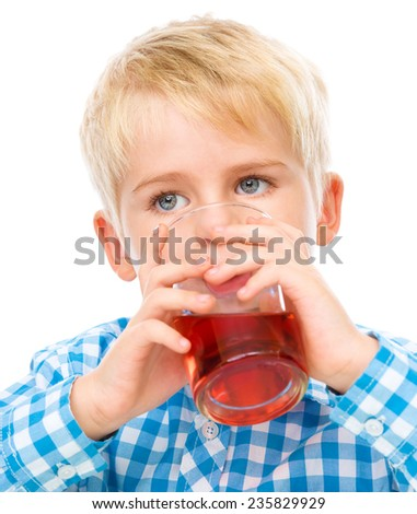 Little boy is drinking cherry juice using straw, isolated over white - stock photo
