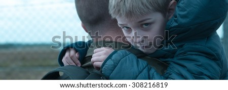 Little boy is holding his father  - stock photo