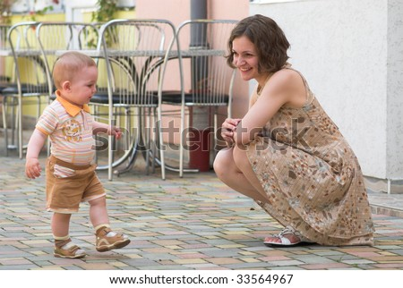 Little boy is making his first steps - stock photo