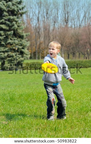 Little boy is playing Frisbee - stock photo