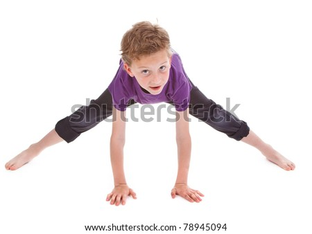 little boy is trying to make spin on white background - stock photo