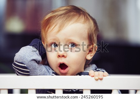 Little boy is waiting in the bed - stock photo