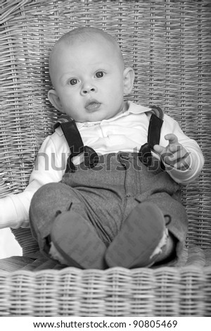 little boy ist sittingn in the chair - stock photo