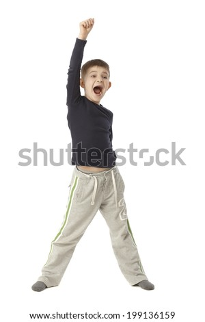 Little boy jittering, standing straddle, lifting right arm, shouting. Full size. - stock photo