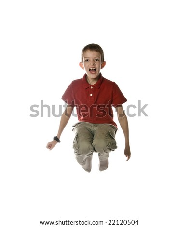 little boy jumping in air, isolated over white - stock photo