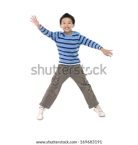 little boy jumping in mid air isolated  - stock photo