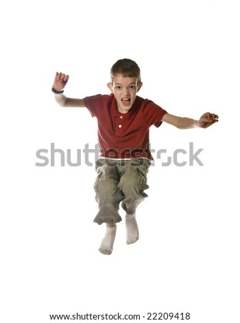 little boy jumping, isolated over white - stock photo