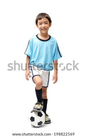 Little boy kicking football on white background - stock photo