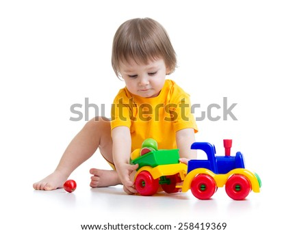 little boy kid playing with car toy isolated - stock photo