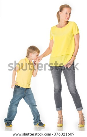 Little boy kissed his mother 's hand. Isolated on white background. Shooting in the studio
