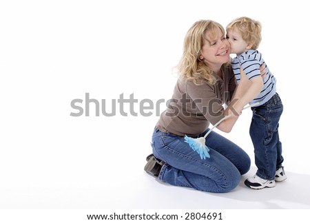Little boy kissing beautiful mom on white background