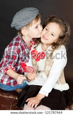 Little boy kissing beautiful smiling little stock photo edit now little boy kissing beautiful smiling little girllentine day thecheapjerseys Gallery