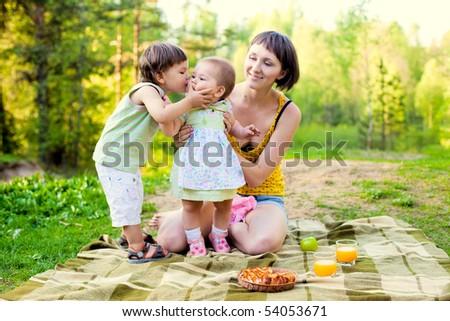 little boy kissing cute baby girl - stock photo
