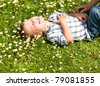 Little boy laying in the grass - stock photo