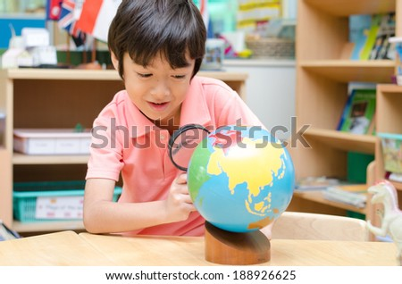 Little boy learning map  - stock photo