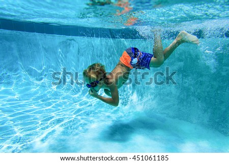 little boy learns swimming underwater