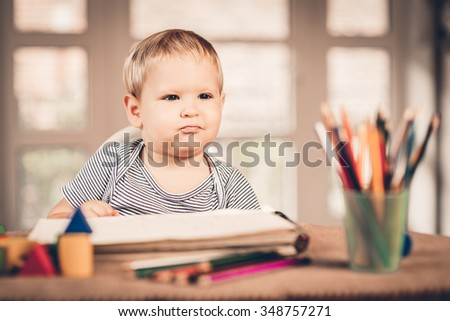 Little boy learns to lines and writes