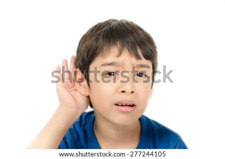 Little boy listening by hand's up to the ear on white background - stock photo