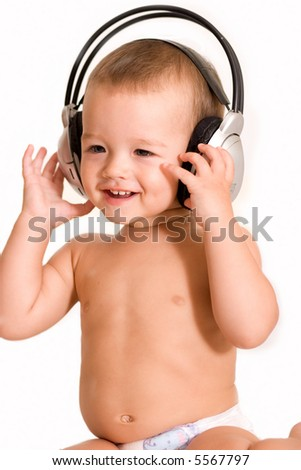 Little boy listening by headphone - stock photo