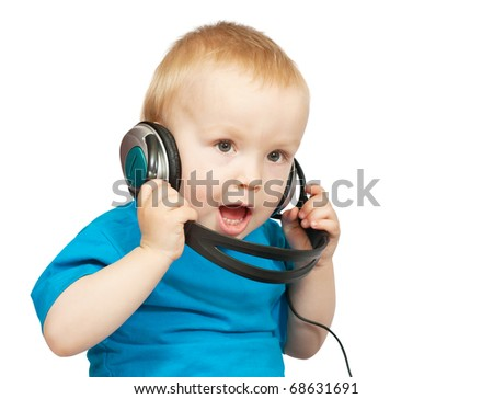 Little  boy listening to music with peaceful expression on face